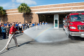 A Seminole State-branded fire truck is hosed down during a ceremony on the Sanford/Lake Mary Campus