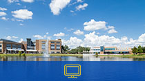 Sanford/Lake Mary Campus UP and Student Center buildings. There is a blue rectangle and desktop icon at the bottom.