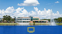 The student center on the Sanford/Lake Mary Campus. There is a blue rectangle with a desktop icon at the bottom.