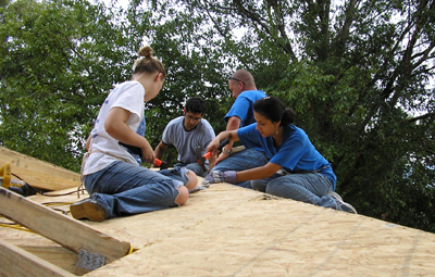 Students working on Habitat house