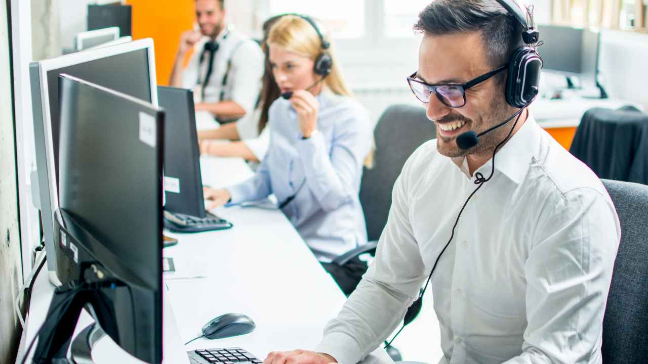 Image of Help Desk person at a computer